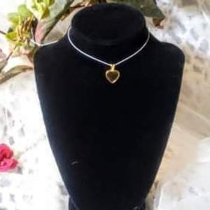 Choker necklace with vintage gold and black pendan